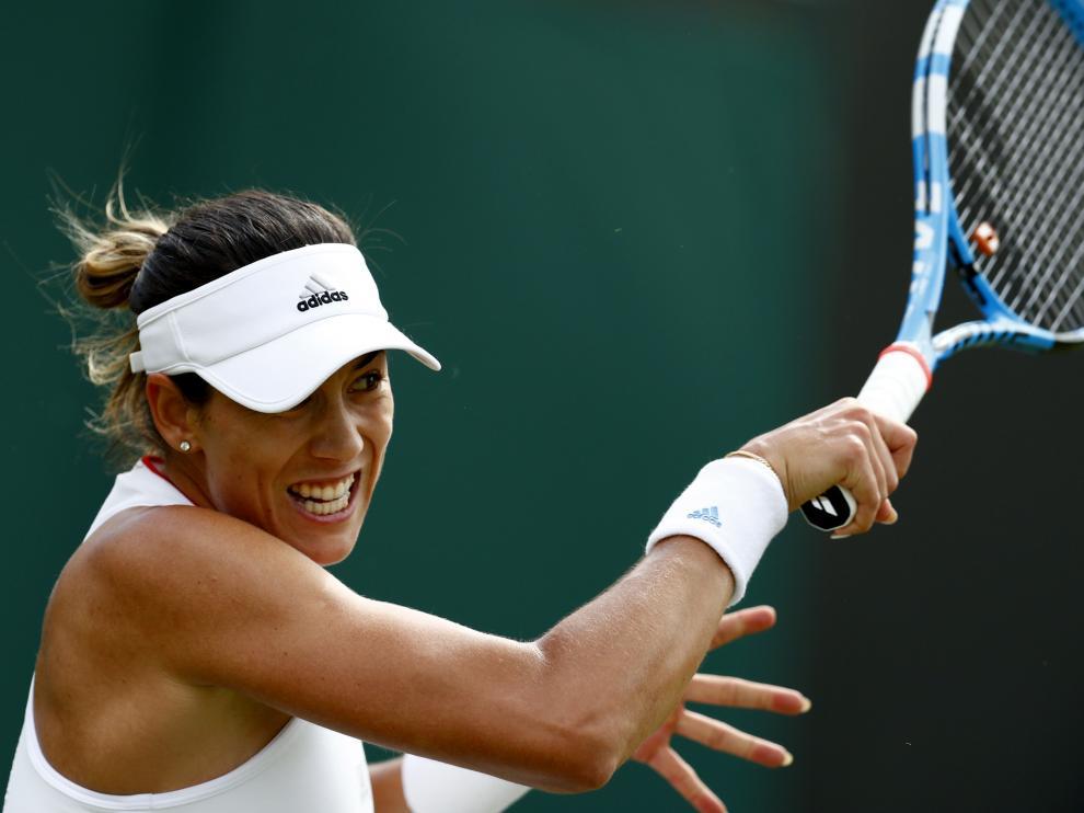 Muguruza, en acción en su debut en Wimbledon 2019