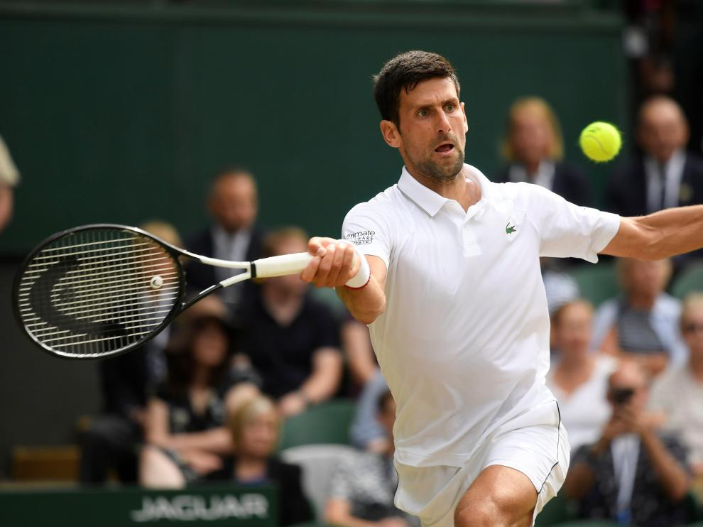 Tennis - Wimbledon - All England Lawn Tennis and Croquet Club, London, Britain - July 12, 2019  Serbia's Novak Djokovic in action during his semi-final match against Spain's Roberto Bautista Agut  REUTERS/Toby Melville [[[REUTERS VOCENTO]]] TENNIS-WIMBLEDON/