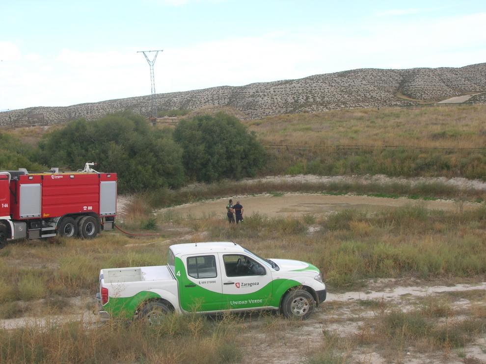 Una pick up de la Unidad Verde, la única que queda operativa, en plena faena.