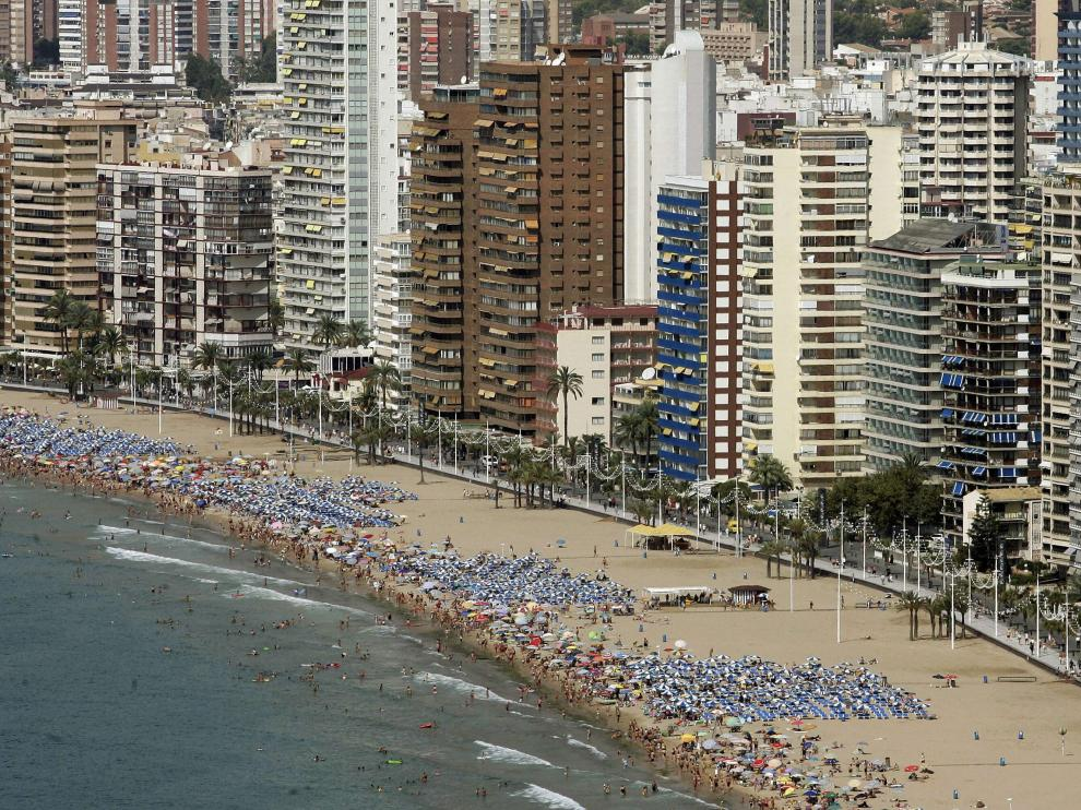 "(FILES) A file picture taken on August 31, 2007 shows a general view of Benidorm on Spain's Costa del Sol. Greenpeace accused Spain on August 8, 2013 of overdeveloping its coastline and warned the problem will only get worse due to a new law which it said makes it easier for new projects close to the shore to get approval. The amount of land within 500 metres of Spain's sunny Mediterranean coast which is built up jumped by 24 percent between 1987 and 2005 to 32,868 hectares as former fishing villages were swallowed up by tourist developments, Greenpeace said in a report presented. The report predicted that Spain's Mediterranean coastline could be ""completely built up"" in 124 years if current trends continue.  AFP PHOTO / JOSE JORDAN SPAIN-ENVIRONMENT-GREENPEACE-TOURISM-FILES"