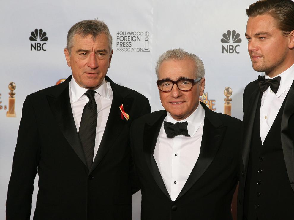 "Oscar-winning director Martin Scorsese (C) stands with US actors Leondardo DiCaprio (R) and Robert De Niro (L), who presented Scorsese the Golden Globes Cecil B. DeMille Award for his ""outstanding contribution to the entertainment field"" during the 67th Golden Globe Awards on January 17, 2010 in Beverly Hills, California. The veteran film-maker, director of classic films including ""Raging Bull,"" ""Goodfellas"" and ""The Aviator,"" has already received two best director Globes during his career for ""The Departed"" and ""Gangs of New York."" AFP PHOTO / Valerie MACON US-GOLDEN GLOBES-SCORSESE"
