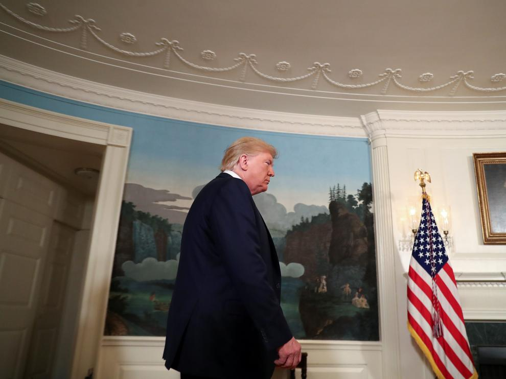 U.S. President Donald Trump arrives to speak about the shootings in El Paso and Dayton in the Diplomatic Room of the White House in Washington, U.S., August 5, 2019. REUTERS/Leah Millis TPX IMAGES OF THE DAY [[[REUTERS VOCENTO]]] USA-SHOOTING/TRUMP