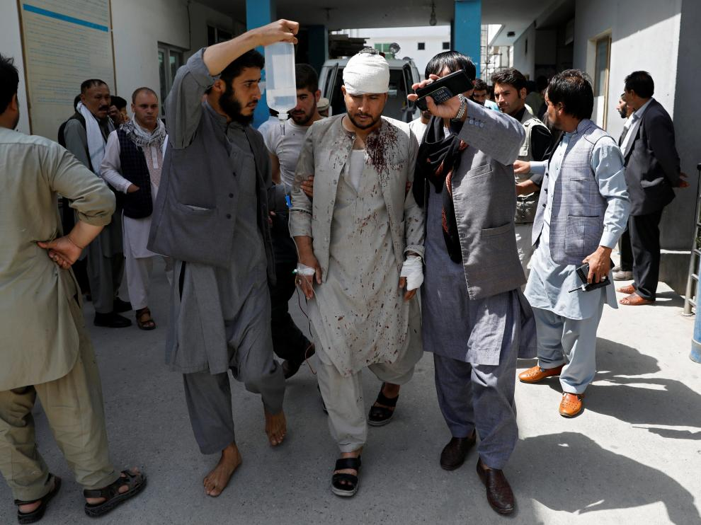 ATTENTION EDITORS - SENSITIVE MATERIAL. THIS IMAGE MAY OFFEND OR DISTURB Men lead an injured man to a hospital after a blast in Kabul, Afghanistan, August 7, 2019.REUTERS/Mohammad Ismail [[[REUTERS VOCENTO]]] AFGHANISTAN-BLAST/