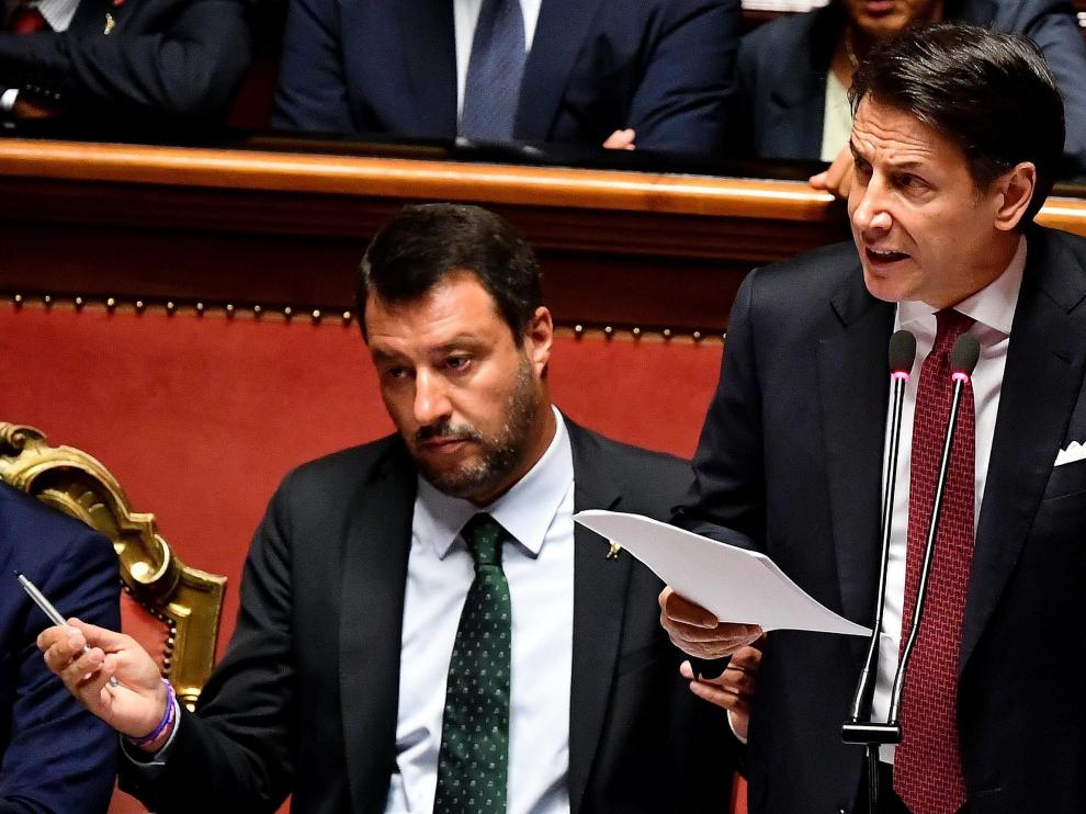 Rome (Italy), 20/08/2019.- Italian Prime Minister Giuseppe Conte (R) is flanked by Deputy Prime Ministers Matteo Salvini (L) as he addresses the Senate in Rome, Italy, 20 August 2019. Conte in his address to the senate called bringing about the government crisis irresponsible. Deputy Premier and Interior Minister Matteo Salvini and his party League pulled out from government and caused a political crisis a week ago. Conte said that the government has come to an end and that he would resign. (Italia, Roma) EFE/EPA/ETTORE FERRARI Italian Premier Giuseppe Conte addresses the Senate