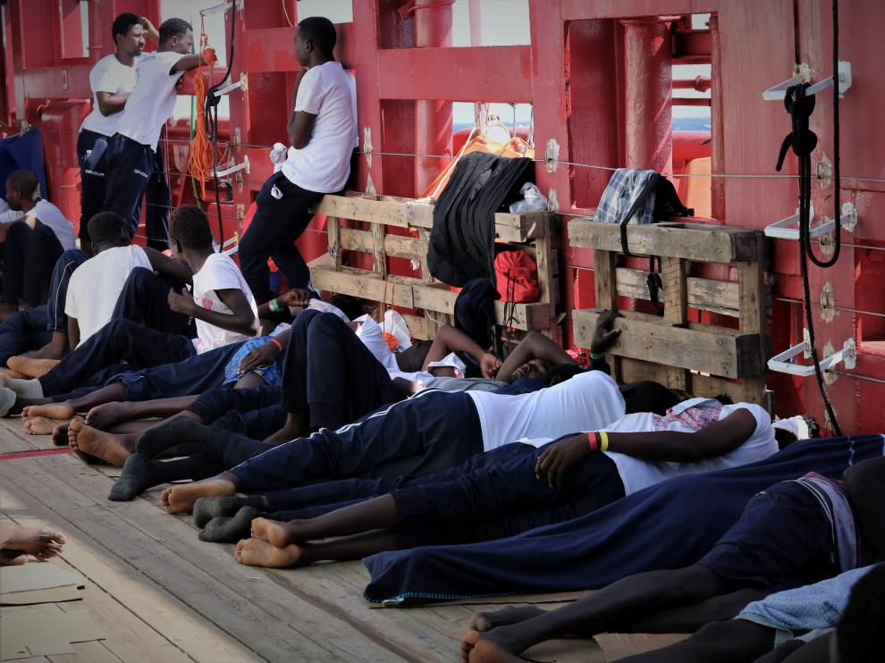 Rescued migrants rest aboard the Ocean Viking, run by French charities Medecins Sans Frontieres and SOS Mediterranee, as it waits in international waters between Malta and the southern Italian island of Linosa for access to a port in this handout picture taken between August 9 and 12, 2019. Ocean Viking/Handout via REUTERS ATTENTION EDITORS - THIS IMAGE HAS BEEN SUPPLIED BY A THIRD PARTY. MANDATORY CREDIT [[[REUTERS VOCENTO]]]
