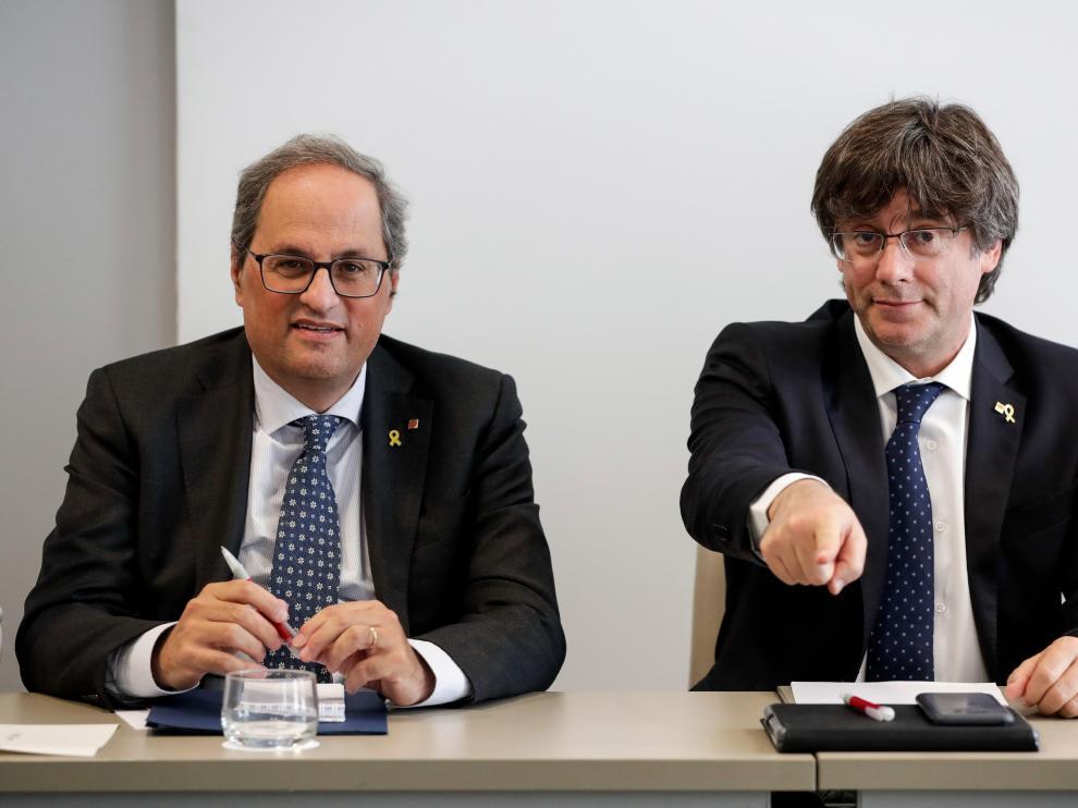 El presidente de la Generalitat de Cataluña, Quim Torra, y el expresidente Carles Puigdemont.