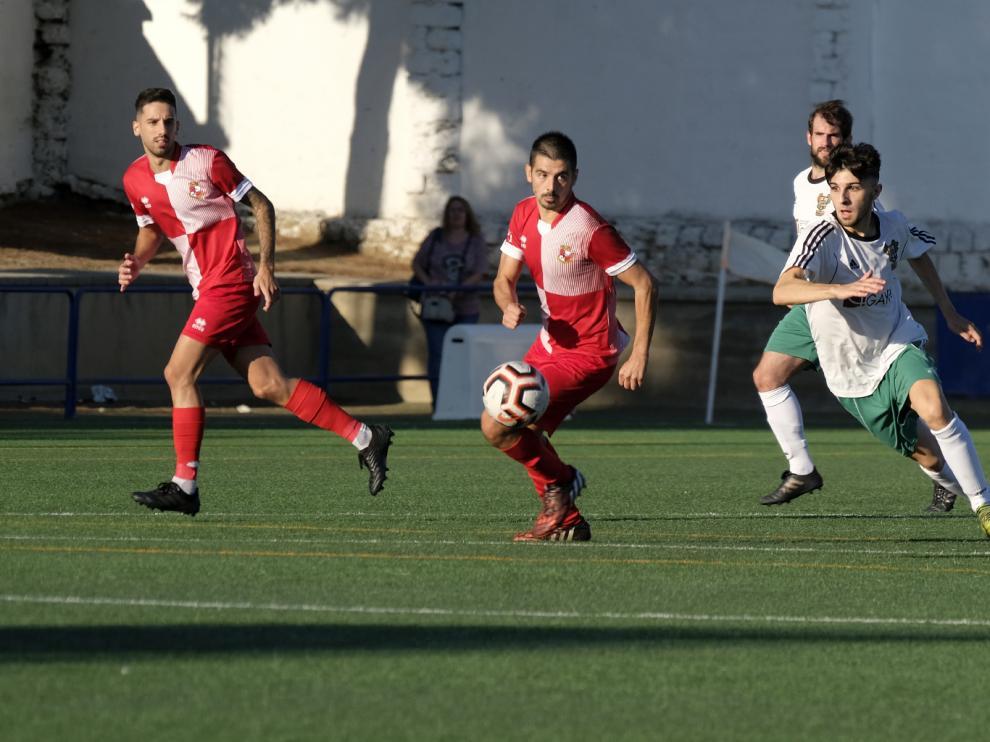 Un lance del partido entre el Peñas Oscenses ante el Actur Pablo Iglesias