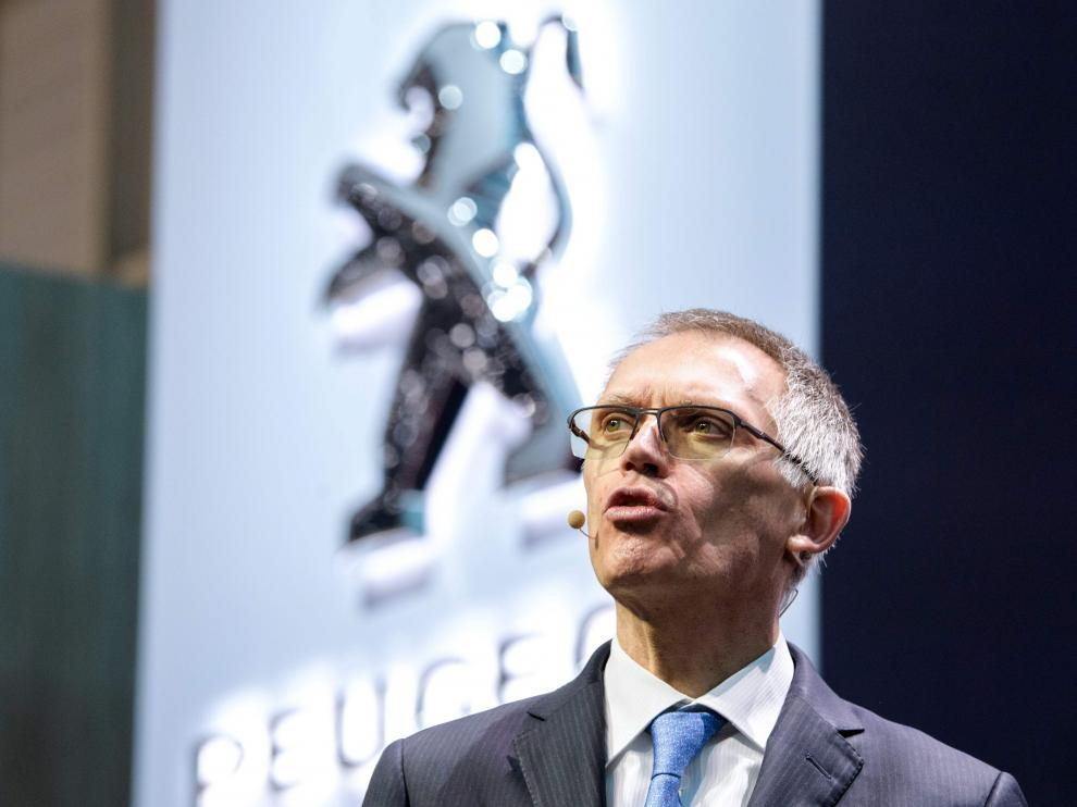 Carlos Tavares, PSA CEO, speaks at the French car maker's booth during a press day ahead of the Geneva International Motor Show on March 6, 2018 in Geneva.The show opens to the public on March 8 and runs through March 18. / AFP PHOTO / HAROLD CUNNINGHAM [[[AFP]]] SWITZERLAND-AUTO-SHOW