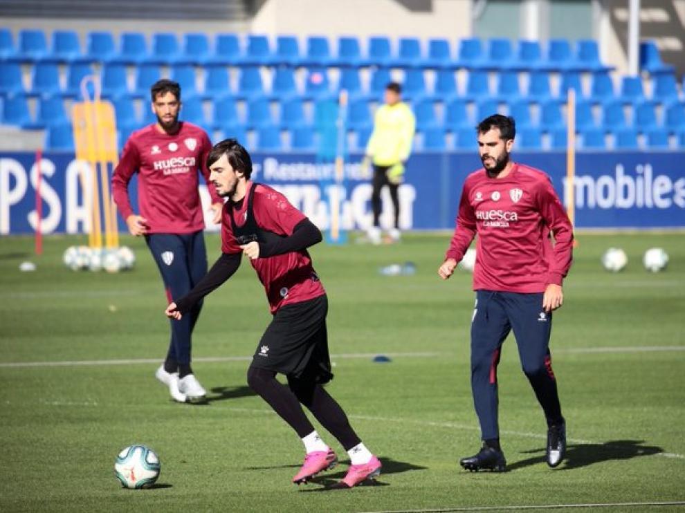 Eugeni y Pablo Insua, en el entrenamiento de este miércoles en El Alcoraz.
