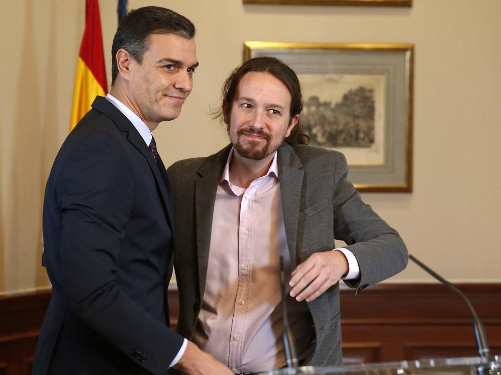 El preacuerdo de gobierno de coalición entre Pedro Sánchez y Pablo Iglesias, en imágenes.