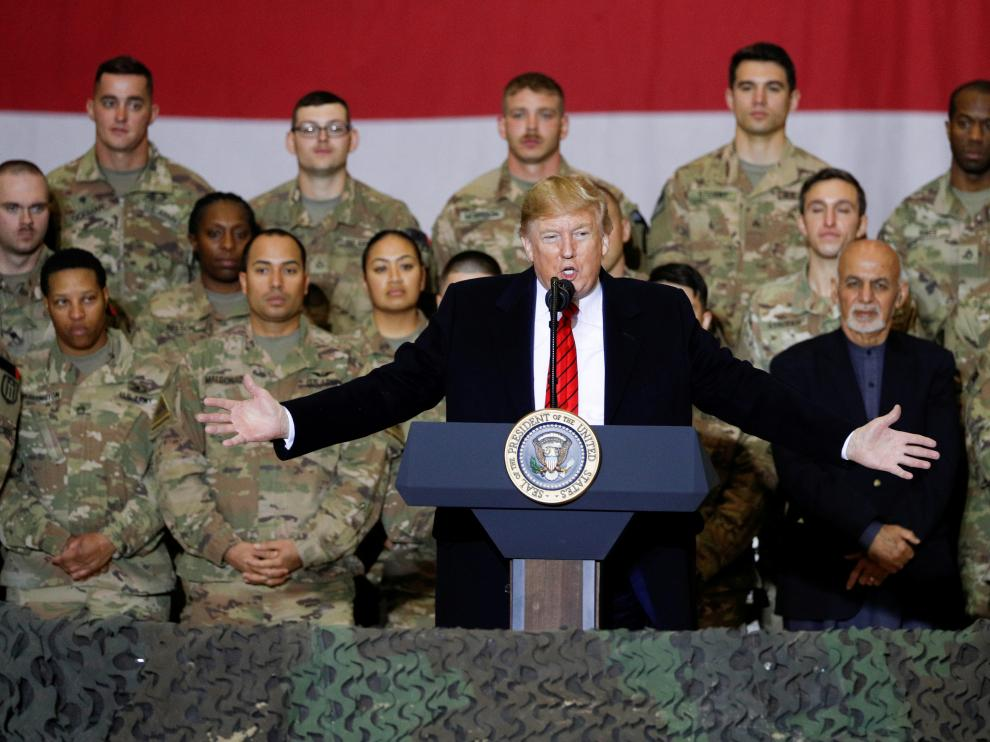 U.S. President Donald Trump delivers remarks to U.S. troops during an unannounced visit to Bagram Air Base, Afghanistan, November 28, 2019. REUTERS/Tom Brenner TPX IMAGES OF THE DAY [[[REUTERS VOCENTO]]] USA-TRUMP/