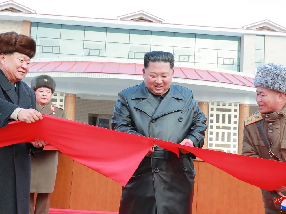 Yangdok County (Korea, Democratic People''s Republic Of), 08/12/2019.- A photo released by the official North Korean Central News Agency (KCNA) on 08 December 2019 shows Kim Jong Un (C), chairman of the Workers' Party of Korea and Supreme Leader of North Korea, cutting a ribbon during a ceremony for the completion of the Yangdok County Hot Spring Cultural Recreation Center in Yangdok County, North Korea. EFE/EPA/KCNA EDITORIAL USE ONLY Supreme Leader of North Korea Kim Jong Un opens Yangdok County Hot Spring Cultural Recreation Center