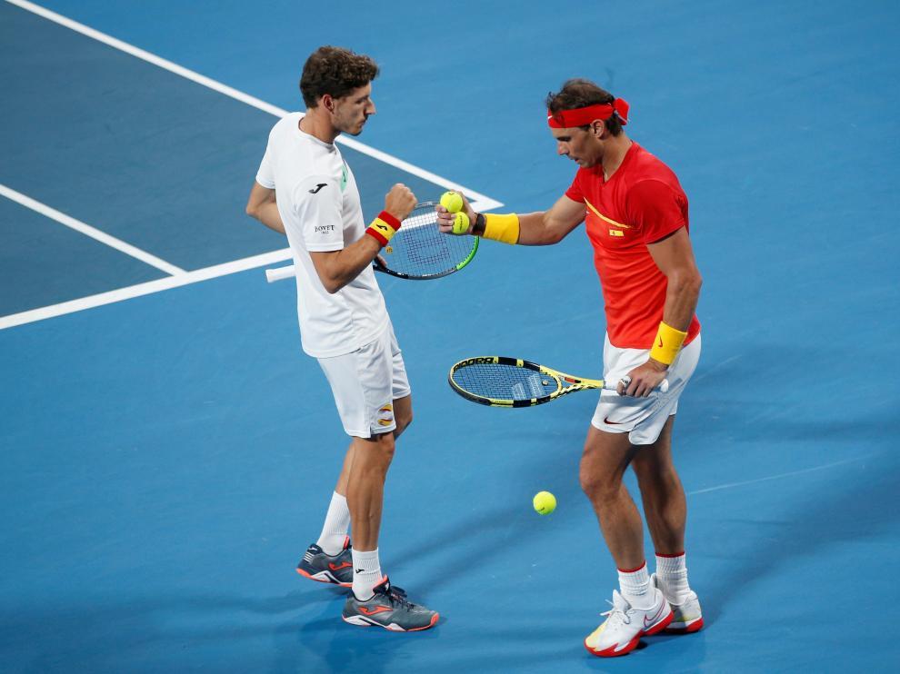Rafa Nadal y Pablo Carreño, en su partido contra Bélgica.