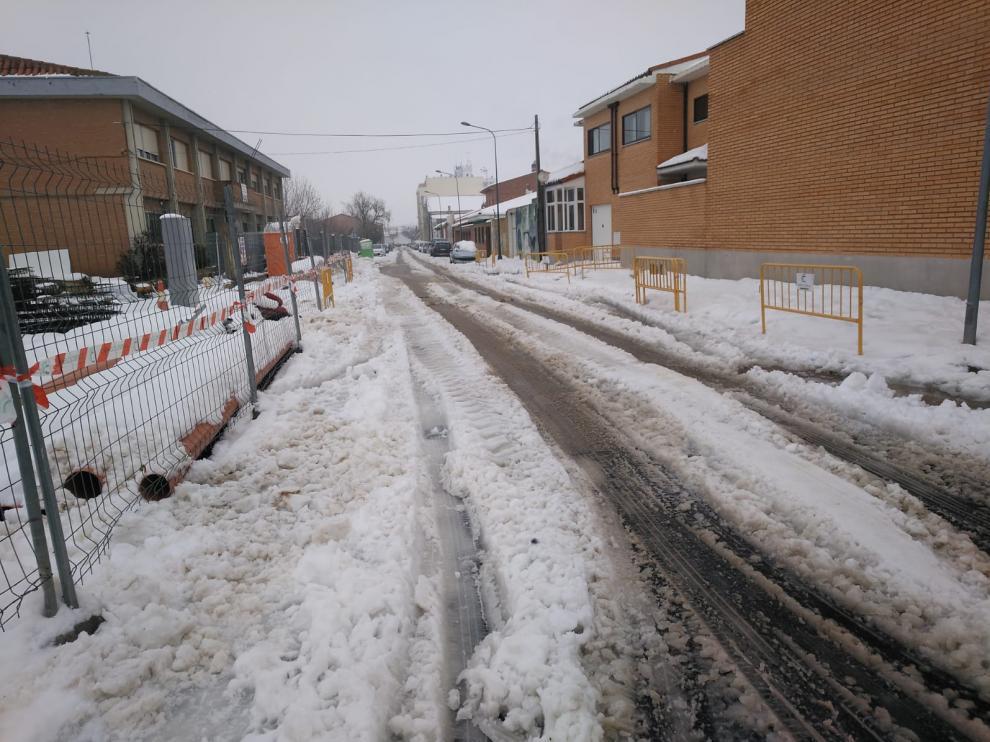 Una calle céntrica de Cariñena, esta mañana cuando no había casi circulación por la nevada.