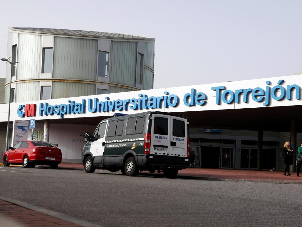 A Spanish civil guard van is seen outside Torrejon University Hospital after two coronavirus cases were identified in Torrejon de Ardoz