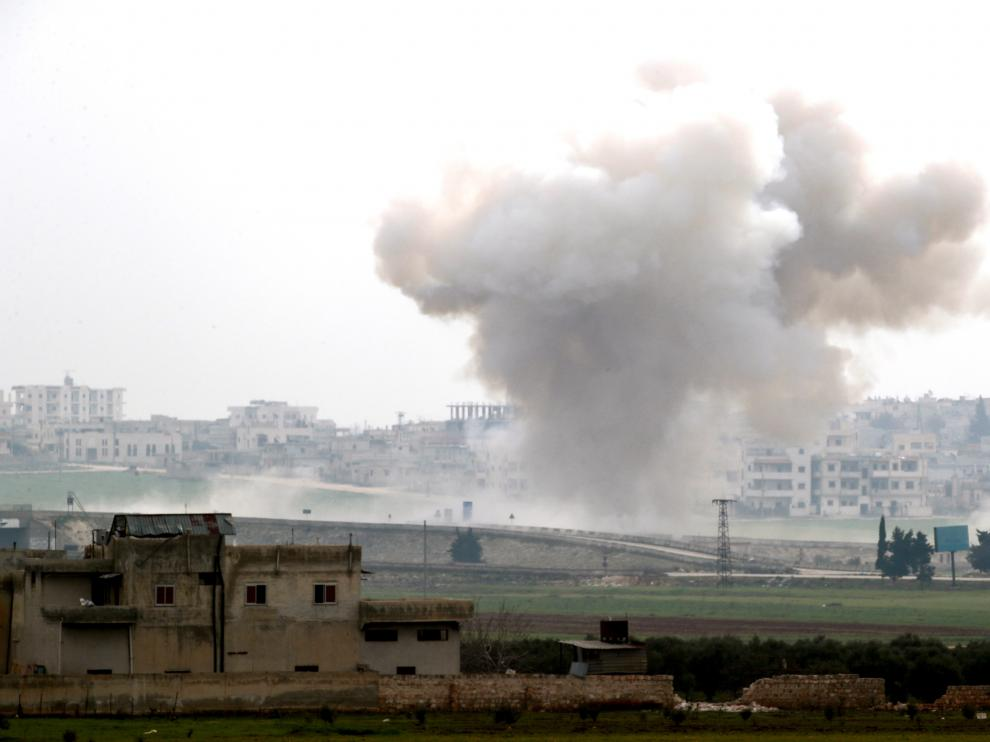 Smoke rises after an air strike in Saraqeb in Idlib province