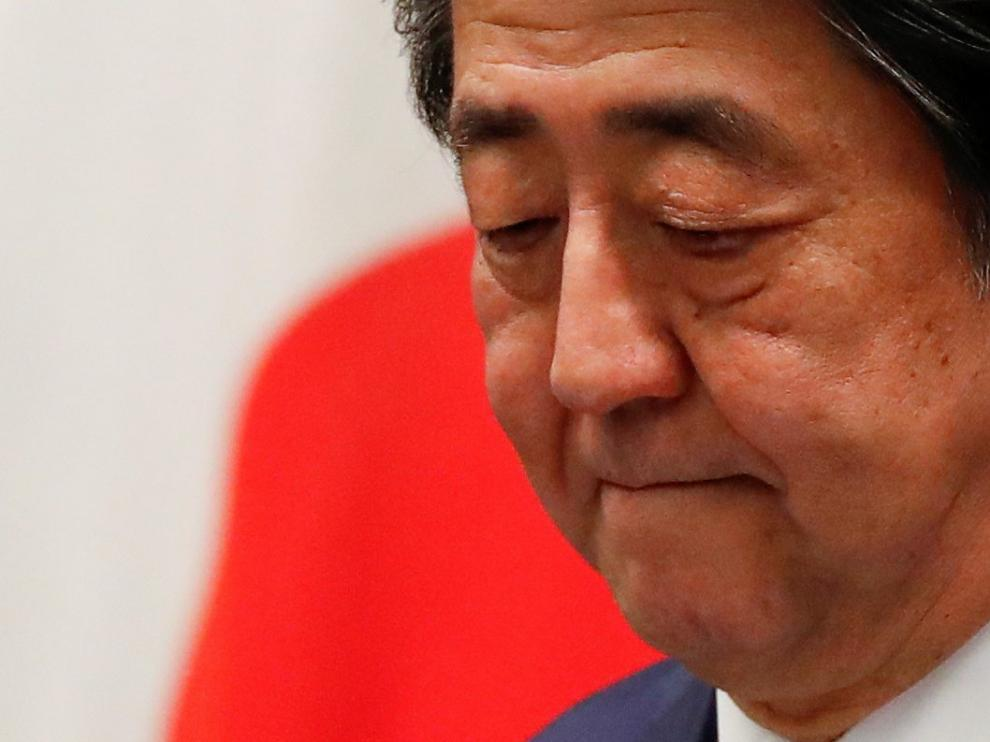 FILE PHOTO : Japan's Prime Minister Shinzo Abe attends a news conference on Japan's response to the coronavirus outbreak at his official residence in Tokyo