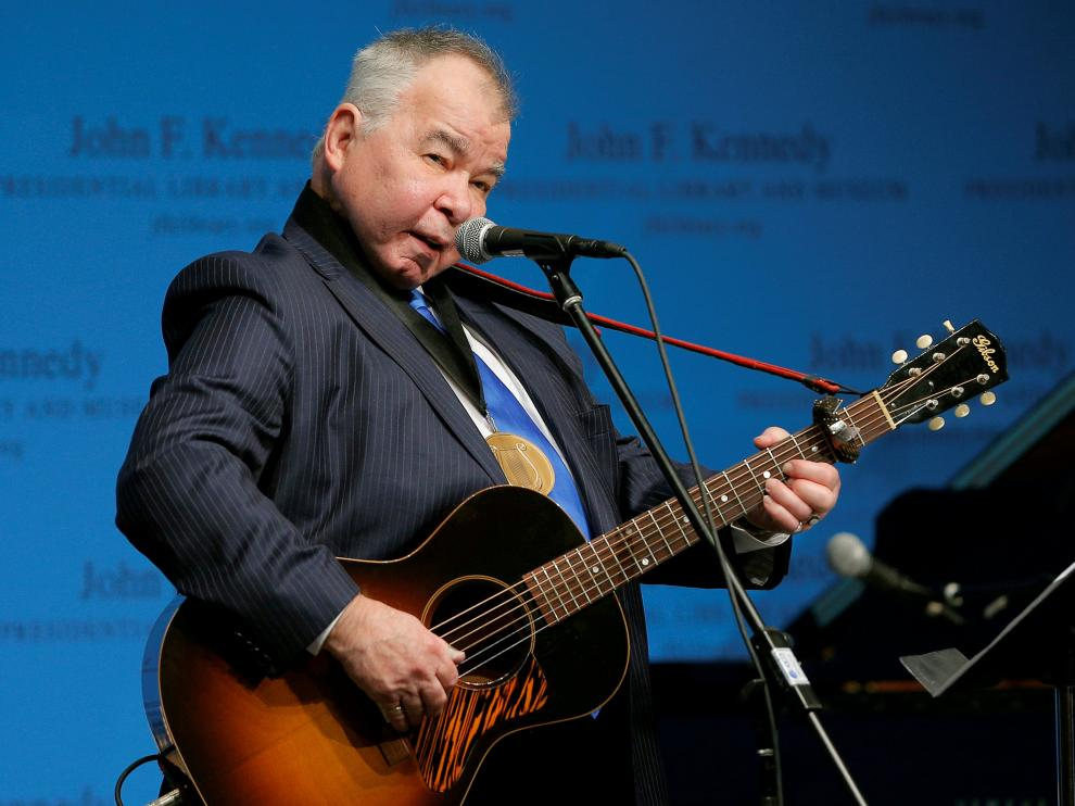 FILE PHOTO: Musician John Prine performs after accepting his PEN New England Song Lyrics of Literary Excellence Award during a ceremony at the John F. Kennedy Library in Boston