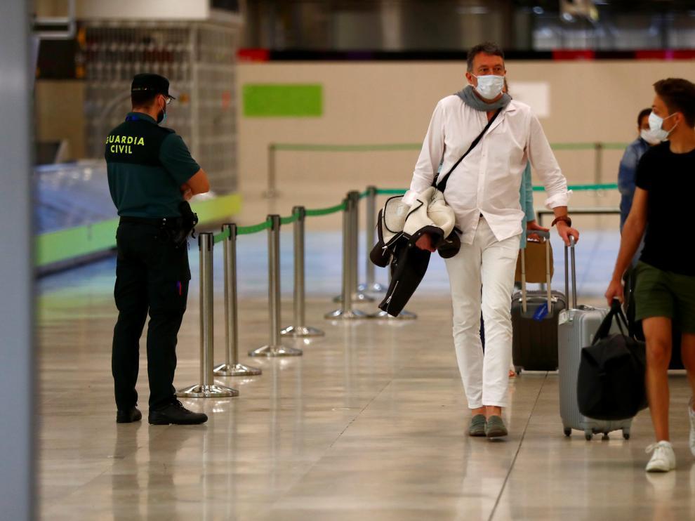 Passengers arrive at Adolfo Suarez Barajas airport in Madrid