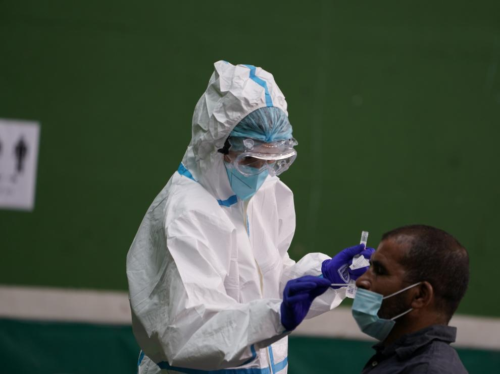 A wine industry worker is being tested for the coronavirus disease (COVID-19) before starting work in Laguardia