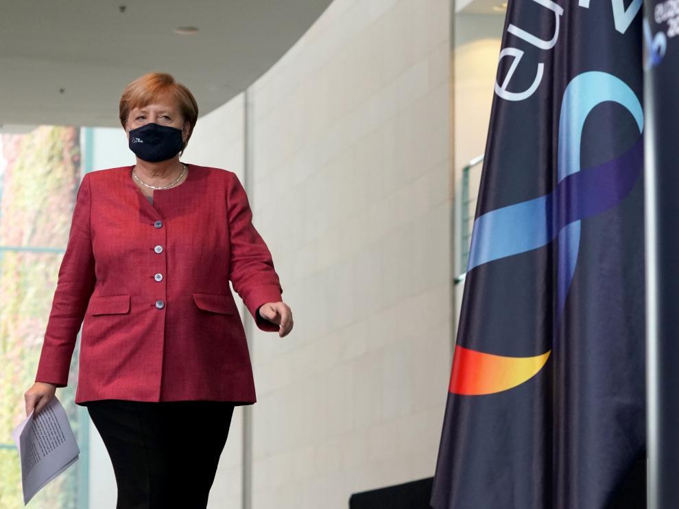 Angela Merkel a su llegada a una conferencia para informar sobre el coronavirus, el viernes en Berlín.