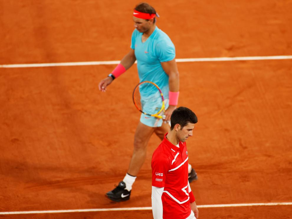 11 October 2020, France, Paris: Spanish tennis player Rafael Nadal returns the ball to Serbia's Novak Djokovic during their men's singles final tennis match of the Roland Garros 2020 French Open tennis tournament, at the Philippe Chatrier court. Photo: Anne-Christine Poujoulat/AFP/dpa11/10/2020 ONLY FOR USE IN SPAIN [[[EP]]] 11 October 2020, France, Paris: Spanish tennis player Rafael Nadal returns the ball to Serbia's Novak Djokovic during their men's singles final tennis match of the Roland Garros 2020 French Open tennis tournament, at the Philippe Chatrier court. Photo: An