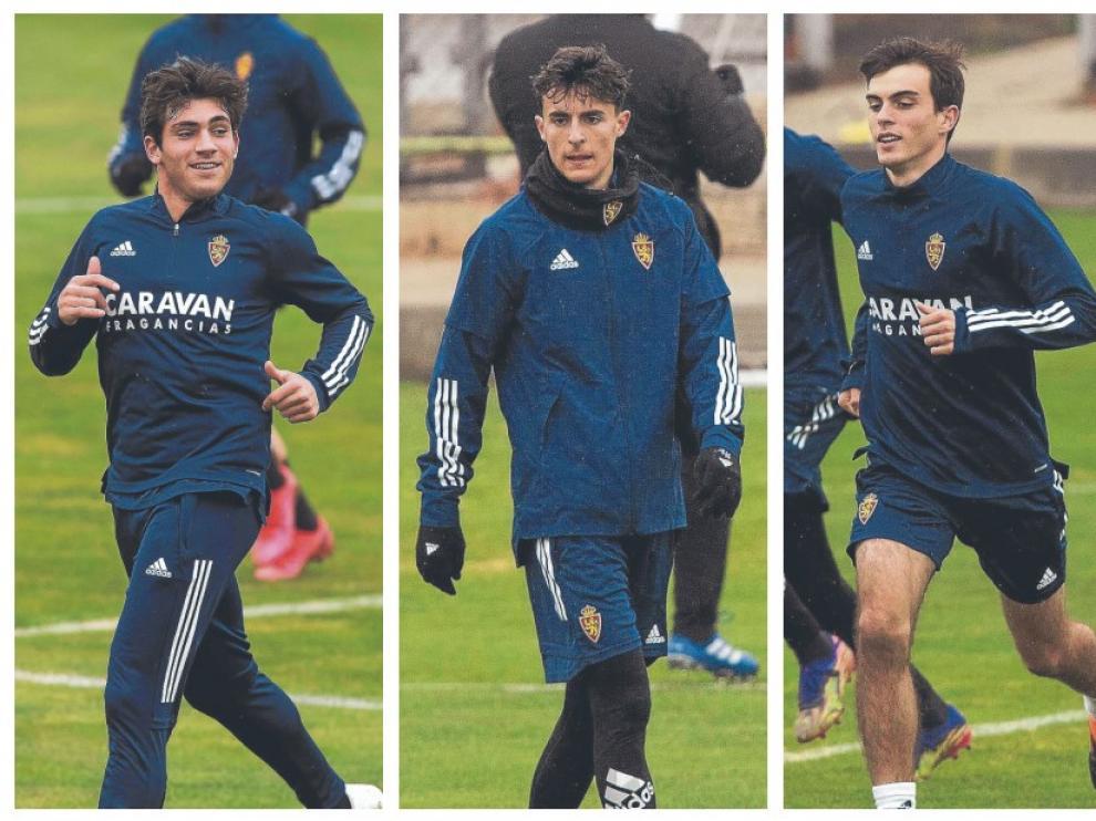 Iván Azón, sonriente, en el entrenamiento de este domingo; Alejandro Francés, en la Ciudad Deportiva; y Francho Serrano, calentando en la sesión de este domingo.