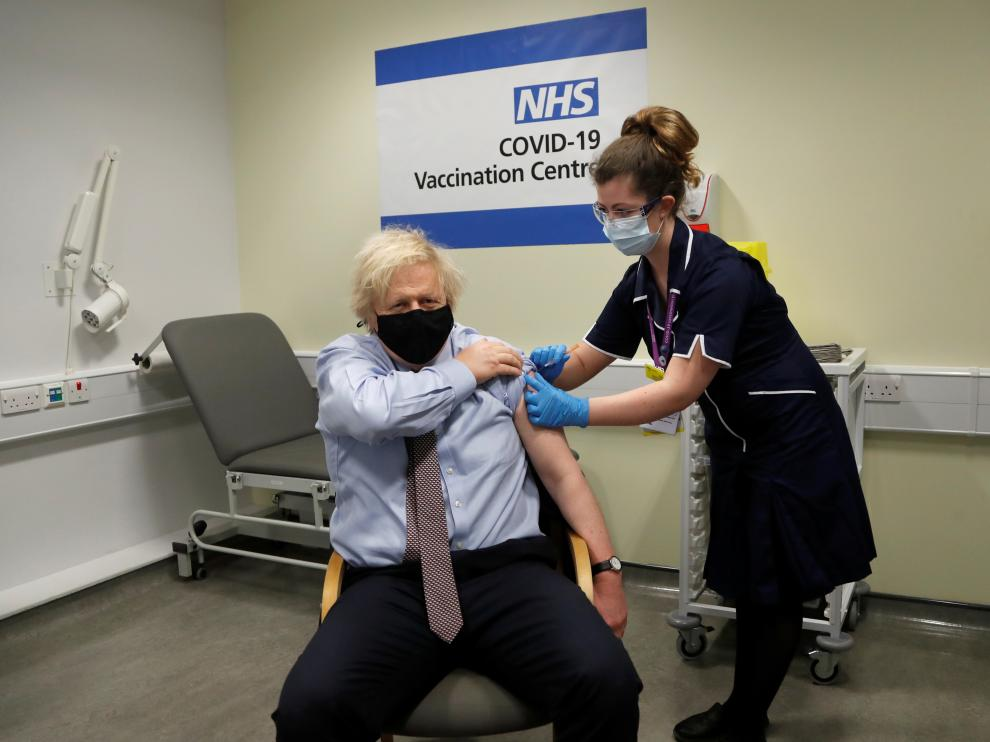 British Prime Minister Boris Johnson receives a dose of the Oxford/AstraZeneca COVID-19 vaccine in London