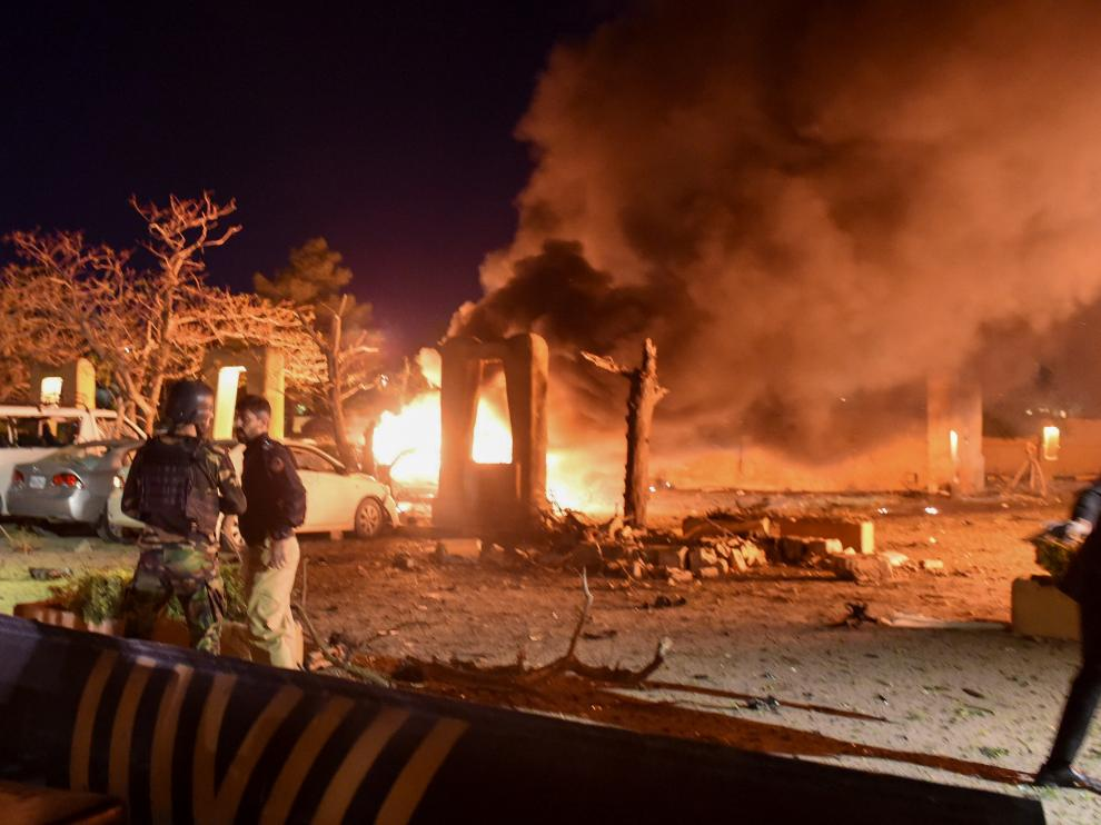 Police and a paramilitary soldier are seen after an explosion at a luxury hotel in Quetta
