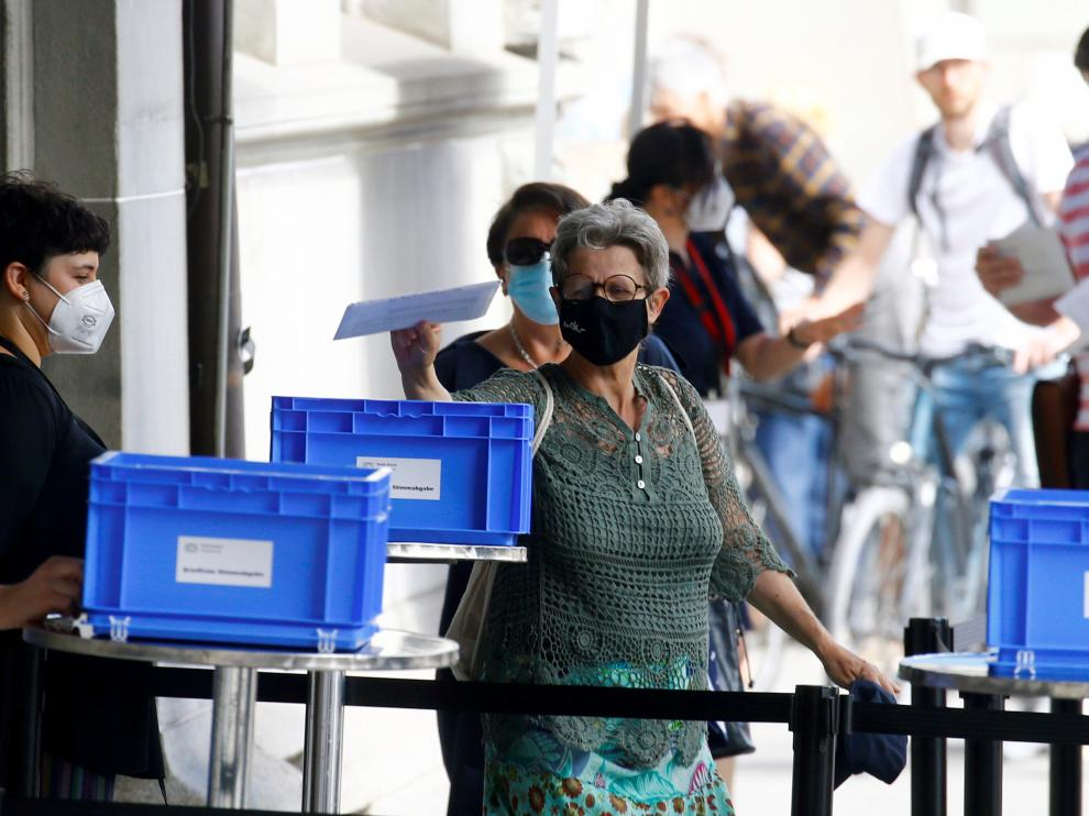 Swiss voters decide on COVID, CO2 laws