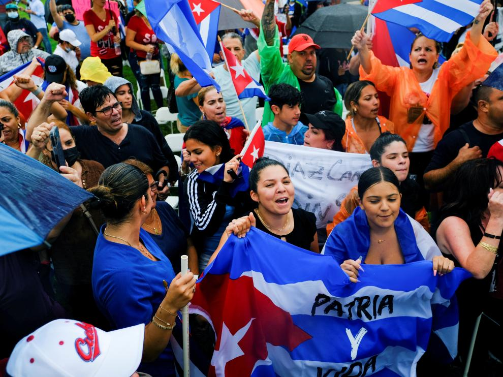 Emigres in the Little Havana neighborhood react to reports of protests in Cuba against its deteriorating economy, in Miami
