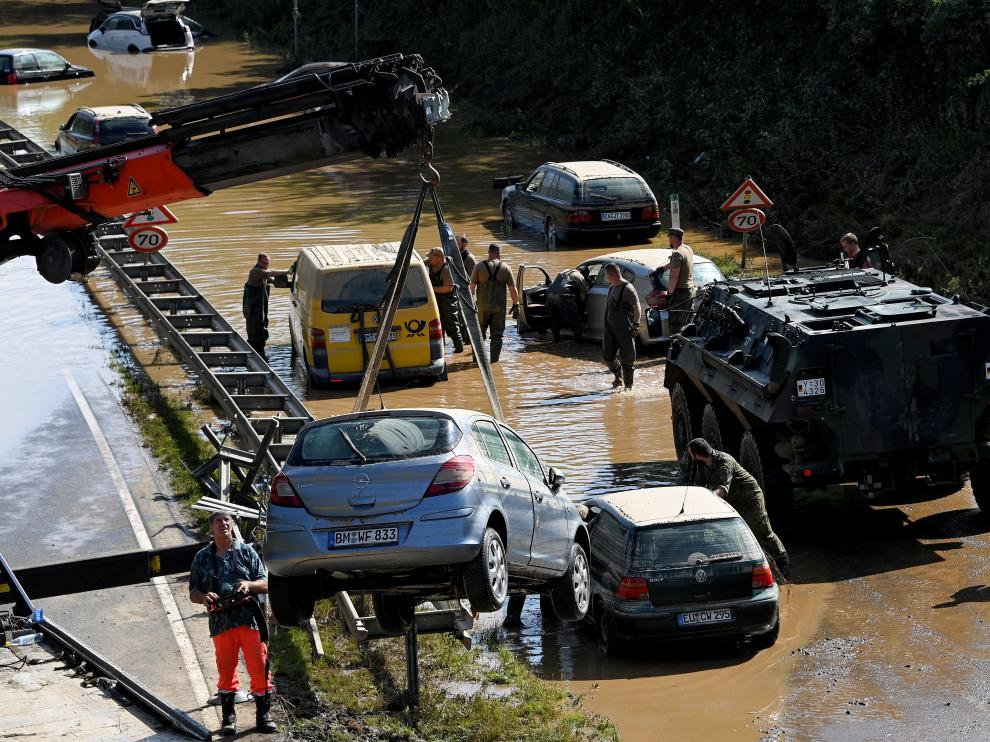 Erftstadt (Germany), 17/07/2021.- Rescue services clear wrecked cars and trucks from the B265 federal highway in Erftstadt, Germany, 17 July 2021. Large parts arts of central Eruope were hit by heavy, continuous rain resulting in local flash floods that destroyed buildings and swept away cars. At least 140 people died in Germany. (Inundaciones, Alemania) EFE/EPA/SASCHA STEINBACH Floodings in Germany