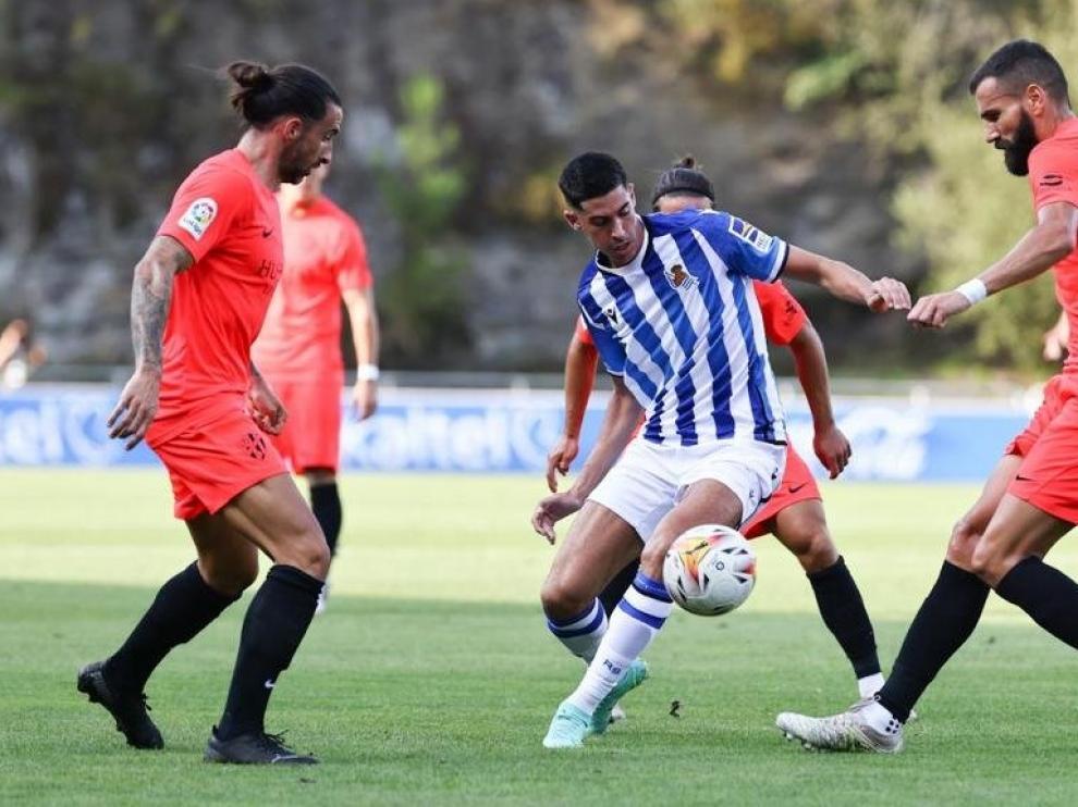 Los jugadores del Huesca han disputado sus primeros minutos.