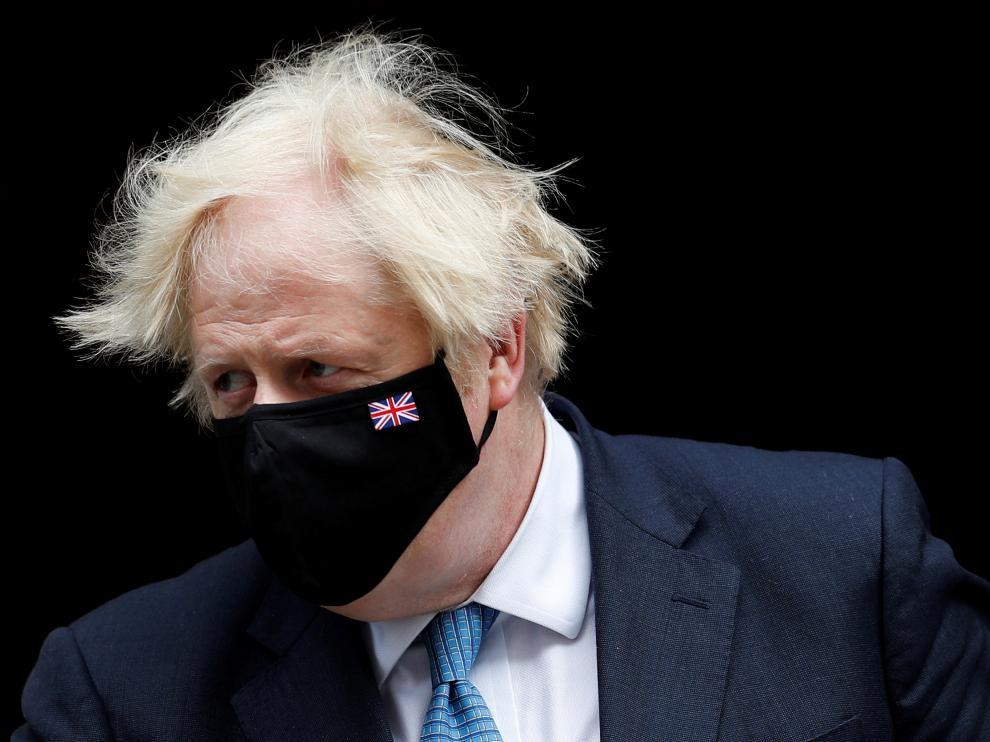 FILE PHOTO: Britain's PM Johnson walks on Downing Street in London