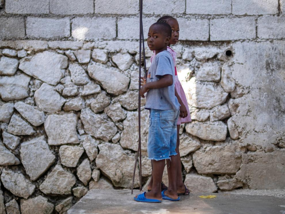 Two children look a the camera while playing in Port-au-Prince