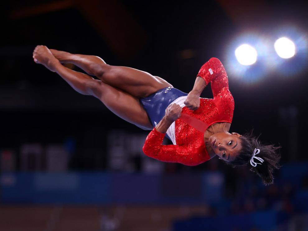 Tokyo 2020 Olympics - Gymnastics - Artistic - Womens Team - Final - Ariake Gymnastics Centre, Tokyo, Japan - July 27, 2021.  Simone Biles of the United States in action on the vault. REUTERS/Lindsey Wasson[[[REUTERS VOCENTO]]] OLYMPICS-2020-GAR/W-TEAM-FNL