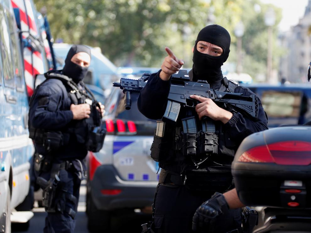 French police forces are seen near the Paris courthouse on the Ile de la Cite in Paris