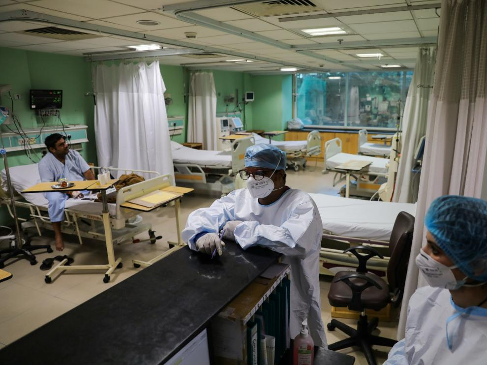Healthcare workers are seen inside a ward for coronavirus disease (COVID-19) patients at Sir Ganga Ram Hospital in New Delhi