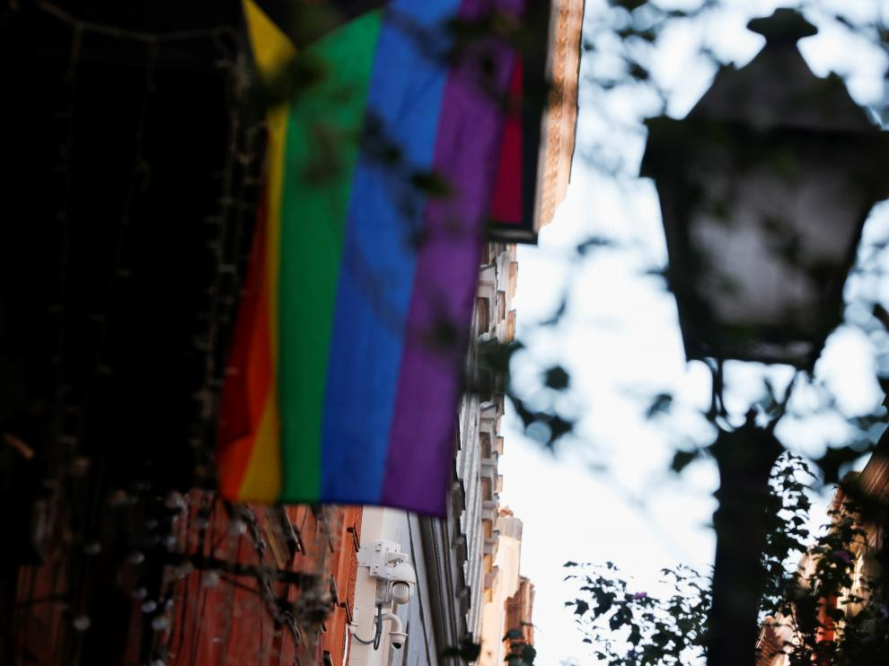 An LGBT flag hangs near surveillance cameras in Malasana neighbourhood, site of a suspected homophobic assault on a 20-year-old Spaniard in central Madrid
