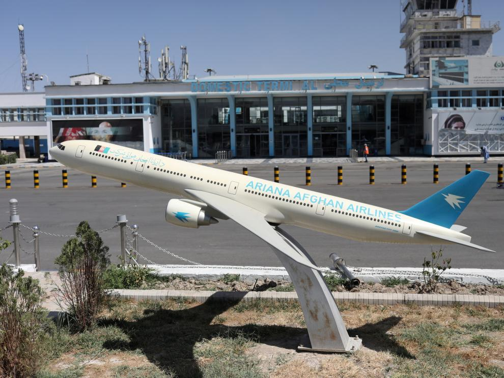 FILE PHOTO: Model of an Ariana Afghan Airlines airplane is seen in front of the international airport in Kabul