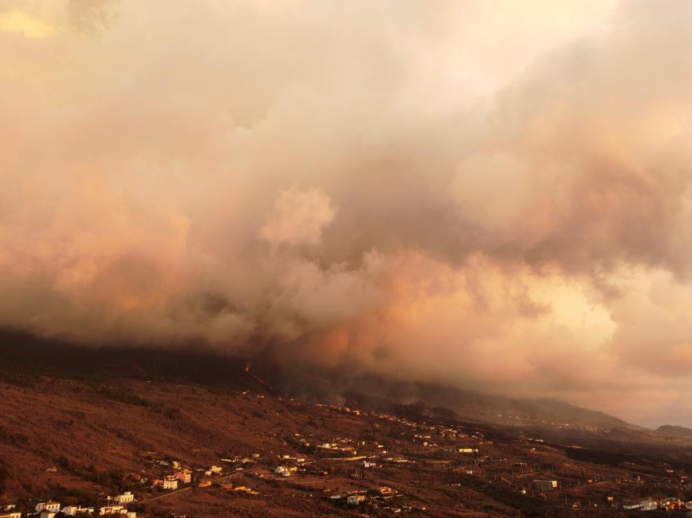 Smoke rises following the eruption of a volcano in Tajuya, on the Canary Island of La Palma