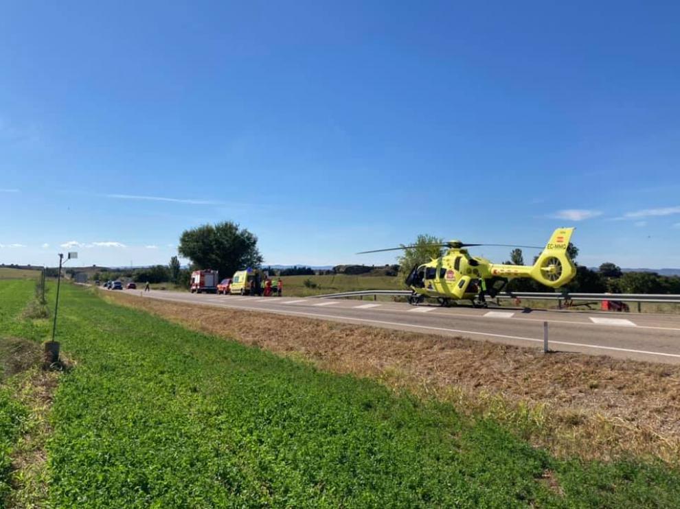 Imagen del lugar del accidente y del helicóptero del 112 que evacuó a la víctima.